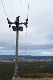 Erica's decides to climb the ski lift