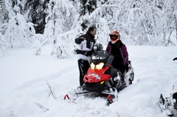 getting tips on how to drive the snowmobile from Micke